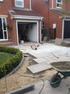 Driveway paving slabs being laid