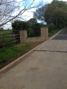 Side wall and entrance to Wetherby driveway