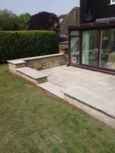 Block paving patio attached to house