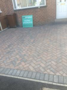 Herringbone driveway with MD Paving sign
