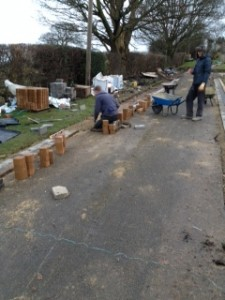 Lining Wetherby driveway with base stone.