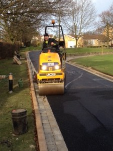 Finishing with the compacter on tarmac driveway