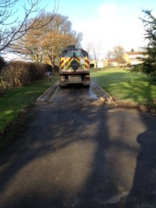 MD Paving roller on long driveway