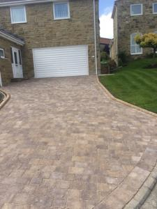 Beautiful brindle block paving upto garage door