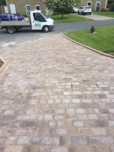 Beautiful brindle block paving with grass verge