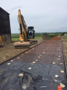 MD Paving machinery laying tarmac road