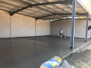 Finishing concrete floor within industrial unit