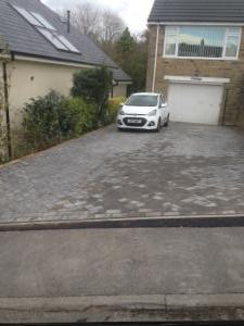 White car on driveway