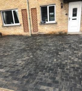 Upgrading the property with block paving and charcoal border